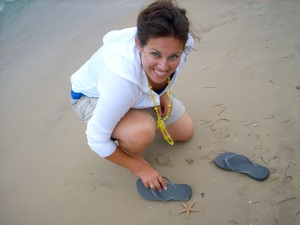 Making friends with a starfish in Alicante, Spain. (From 2008.)