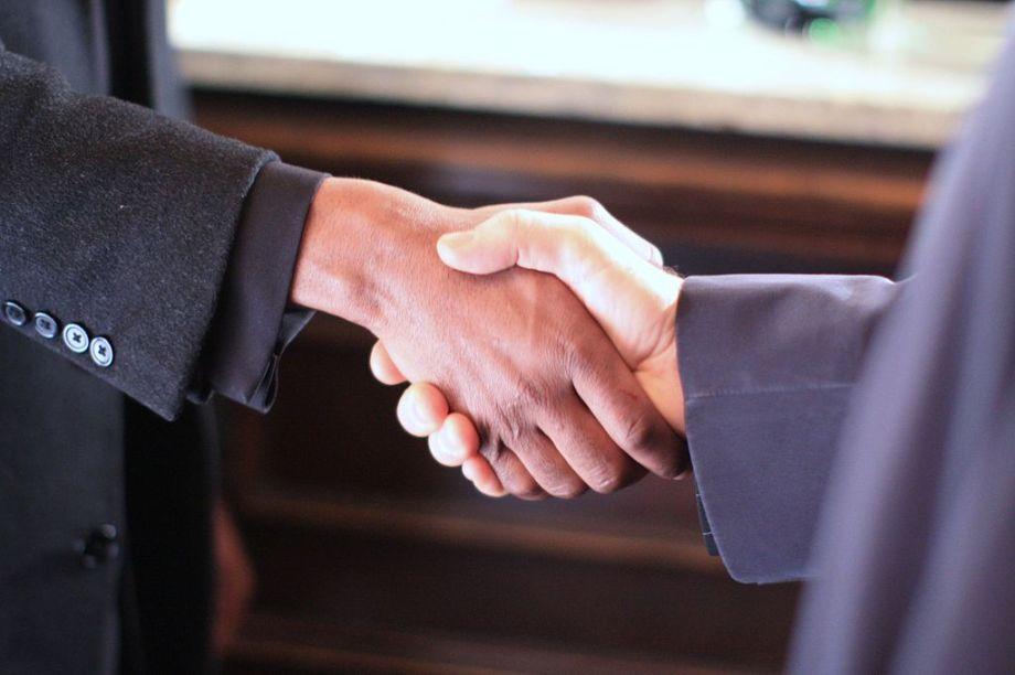 1024px-black__white_handshake_-_still_from_the_film_colour_blind_2009
